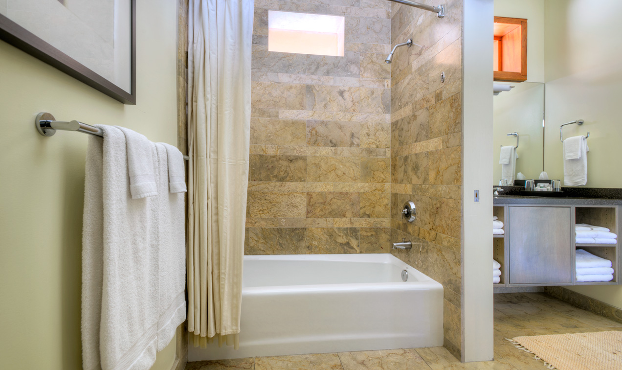 Desert Pearl Inn Premium King large clean bathroom features privacy area and bidet.