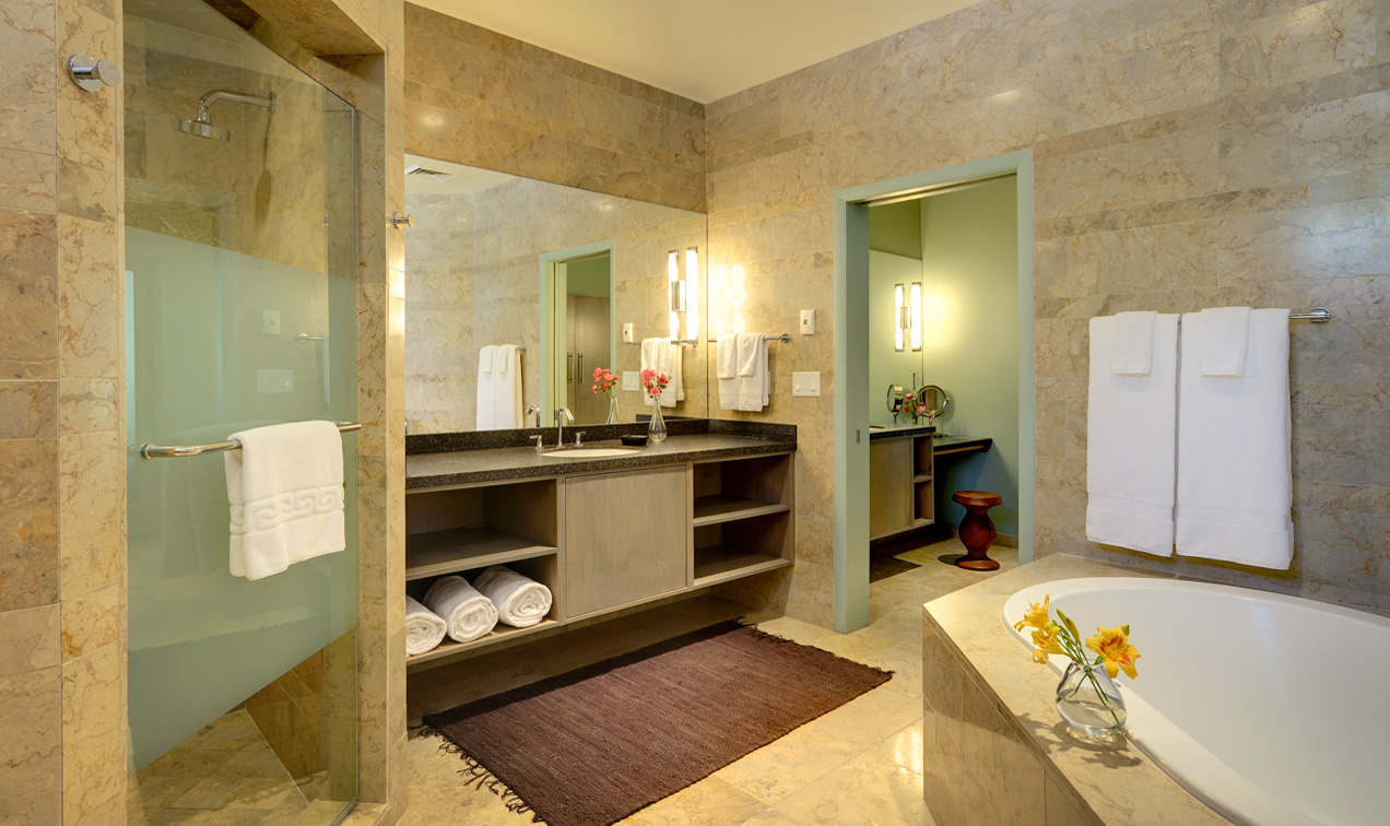 Luxurious King Suite bathroom at Desert Pearl Inn with bidet, jetted tub, walk-in shower and private vanity area