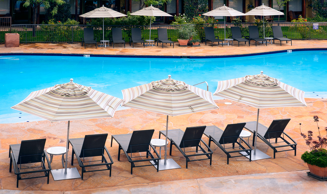 Poolside chairs next to large saline pool at Southern Utah popular family hotel
