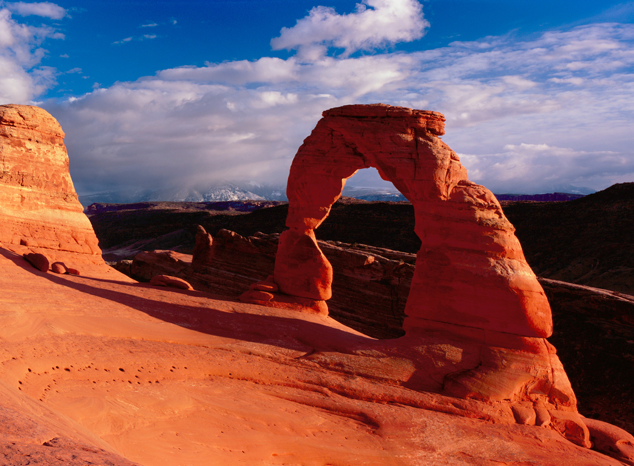 Delicate Arch and Arches National Park is a popular stop on the Grand Circle loop.